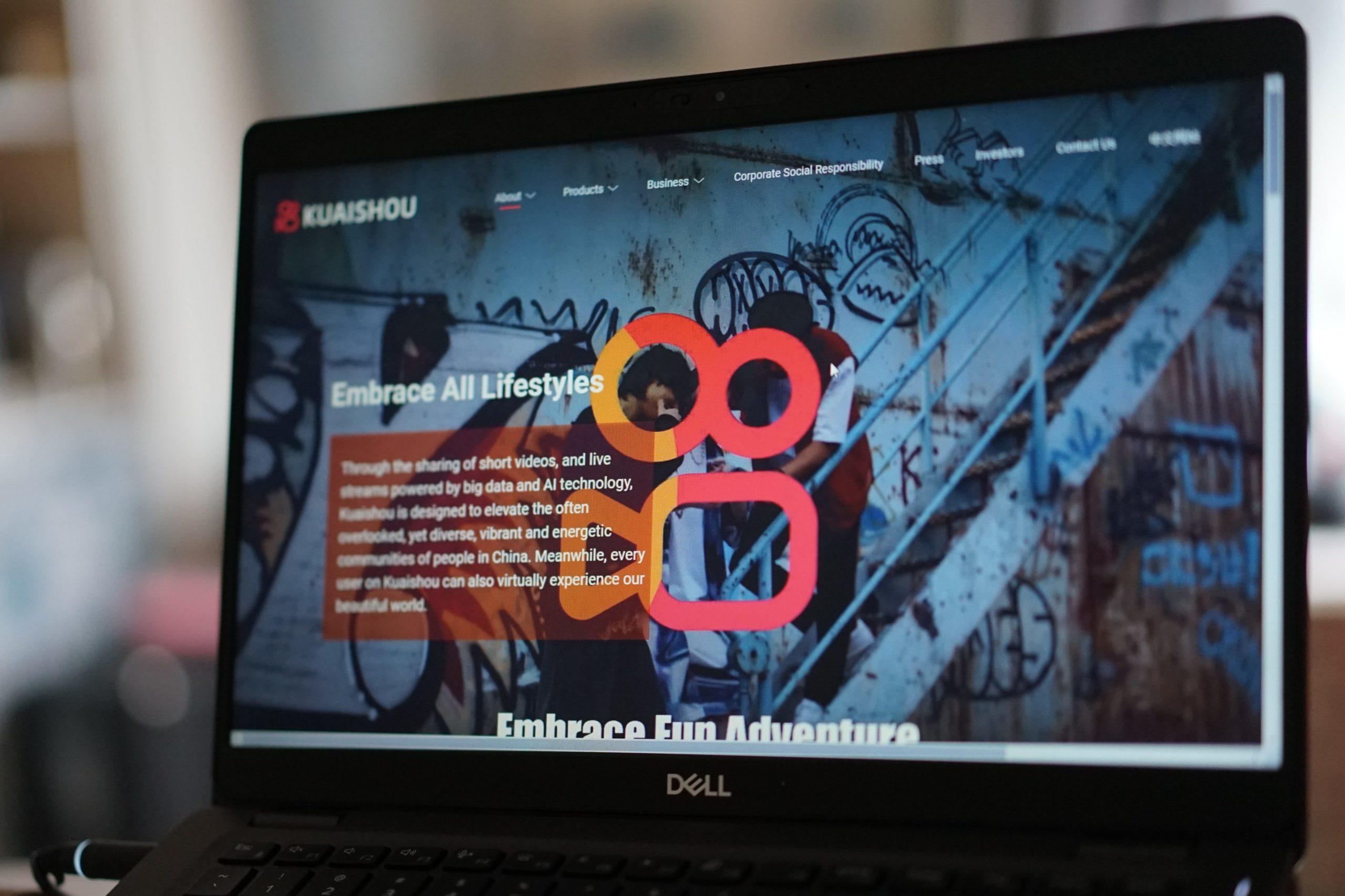 A computer screen featuring Kuaishou's logo.